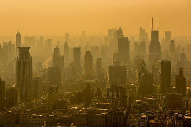 Shanghai Skyline. Shanghai, China - Oct 12, 2015: Pollution is one aspect of the broader topic of environmental issues in China. Various forms of pollution have increased as China has industrialized, which has caused widespread environmental and health problems. smog stock pictures, royalty-free photos & images