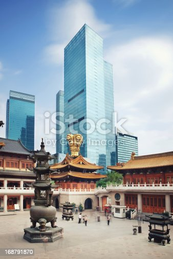 Traditional Budhist temple and skyscrapers in Shanghai,, China