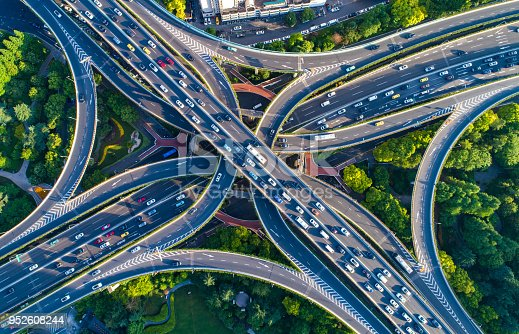 618059920 istock photo shanghai viaduct and cityscape 952608244