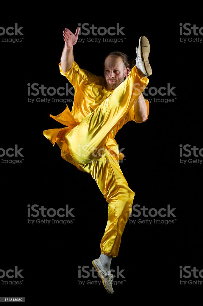 Shaolin Kung Fu warrior in midair royalty-free stock photo