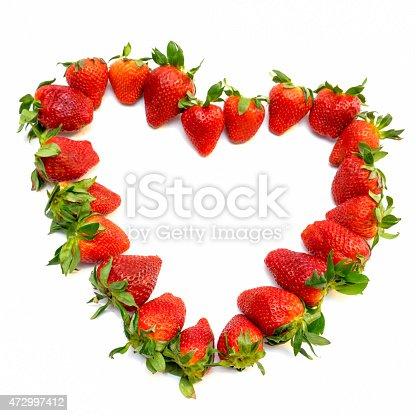 istock Shape of heart made of fresh strawberries 472997412