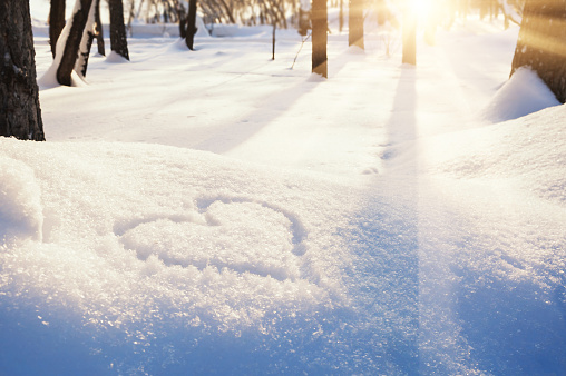 Shape of heart on the snow. Winter landscape