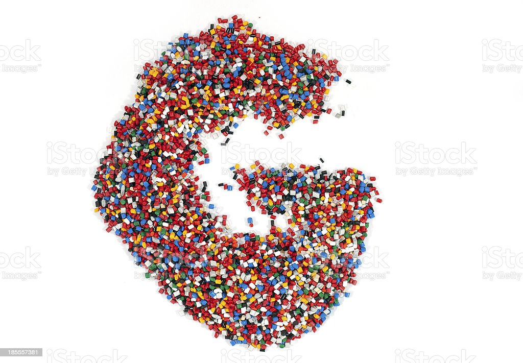 G shaped colorful plastic polymer granules stock photo