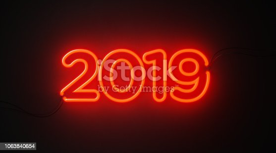 2019 shaped red neon light on black wall. Horizontal composition with copy space. Great use for Christmas concepts.