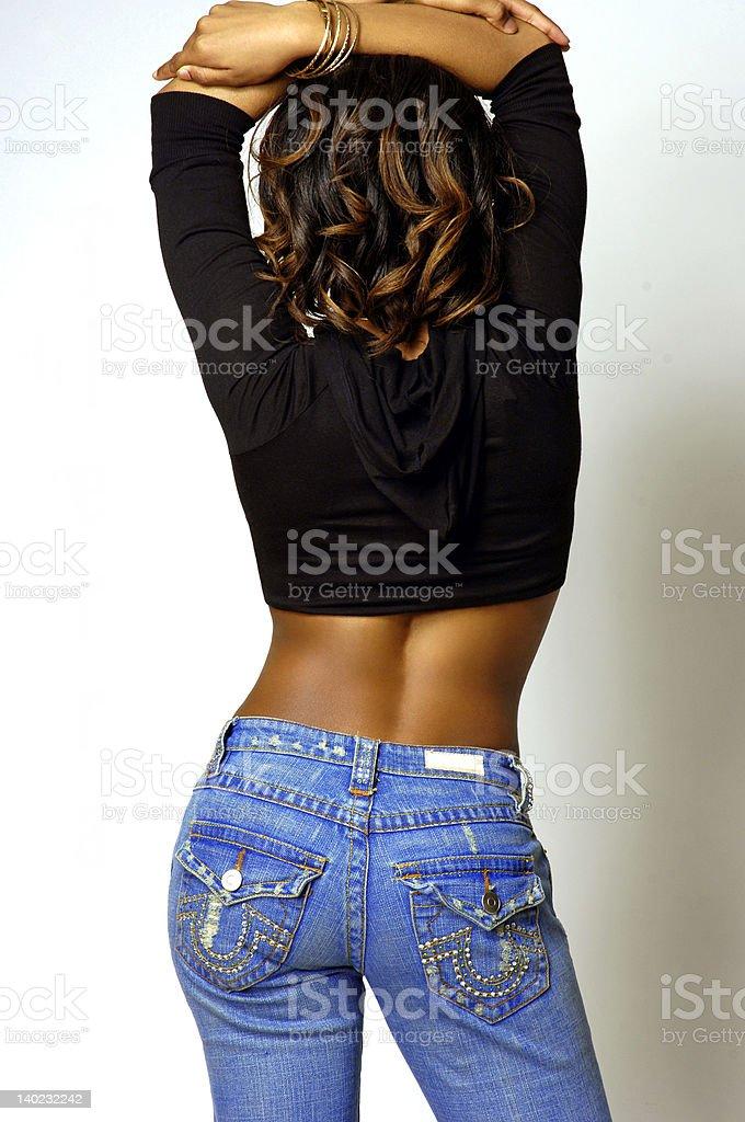 Обтягивающие молодая женщина с вид сзади стоковое фото