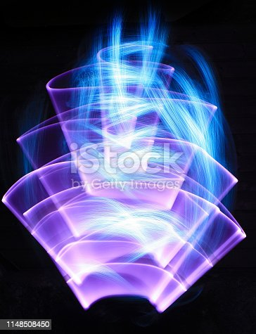 Curved shape made of neon and white streaks made to optical fiber at lightpainting