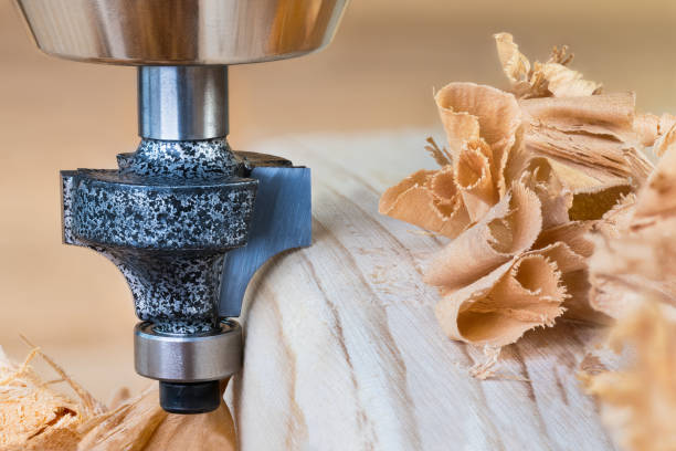 Shaping copying shank router bit clamped in chuck of a working machine tool stock photo