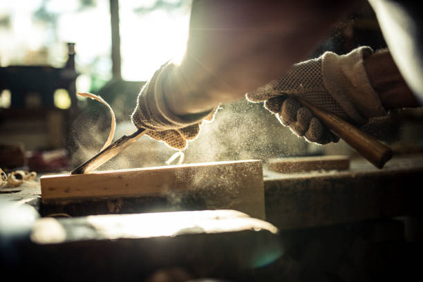 Shaping wood A caucasian senior adult carving wood in a workshop craftsperson stock pictures, royalty-free photos & images