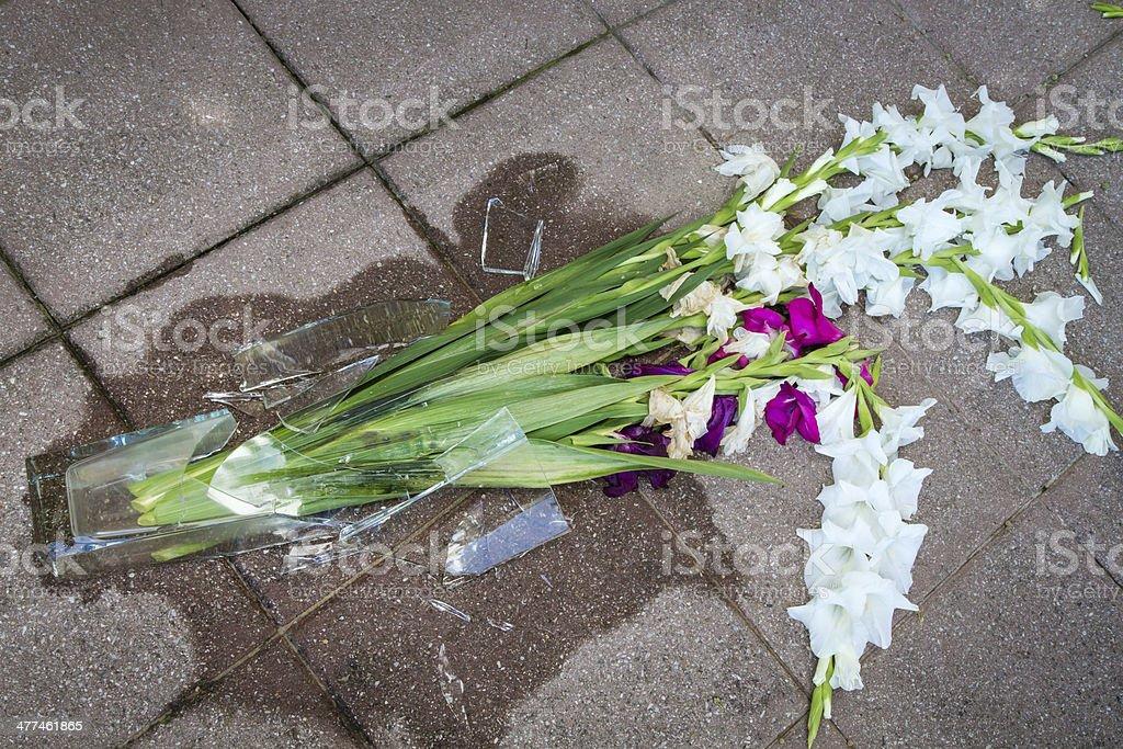 Shards of a broken vase on the floor stock photo