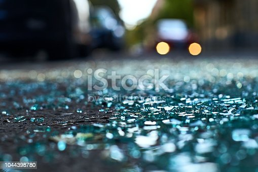istock Shards of car glass on the street 1044398780