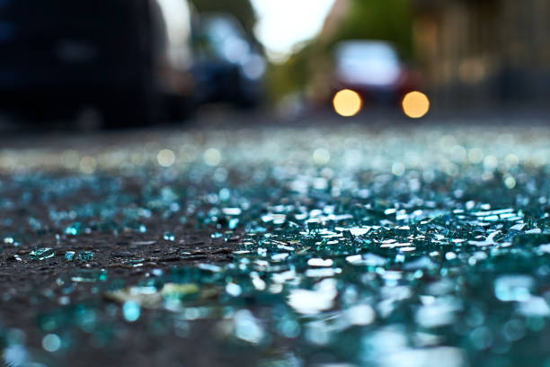 Shards of car glass on the street stock photo