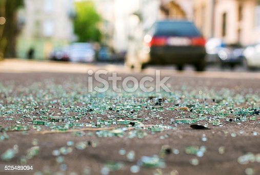 istock Shards of car glass on the street 525489094