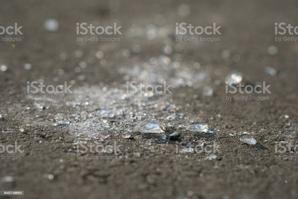 Shards of glass on the ground stock photo