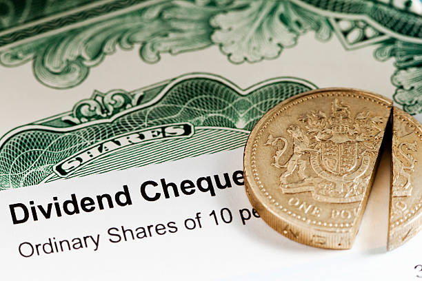 uk share dividend - guilloche stock photos and pictures