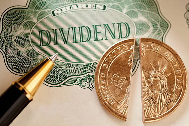 share dividend us dollar - guilloche stock photos and pictures