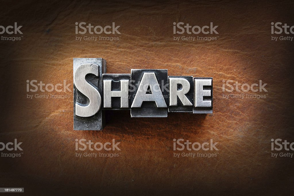 Share The word share made from vintage lead letterpress type on a leather background. Aging Process Stock Photo