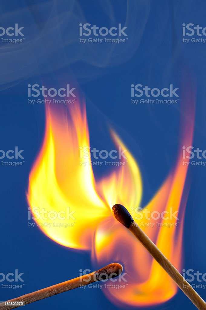 Share the Fire; Flame Spreads From One Match to Another royalty-free stock photo
