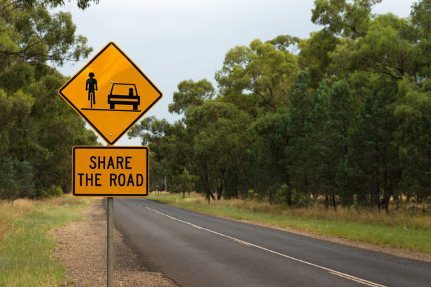 Share the road with cyclists Australian warning road sign stock photo