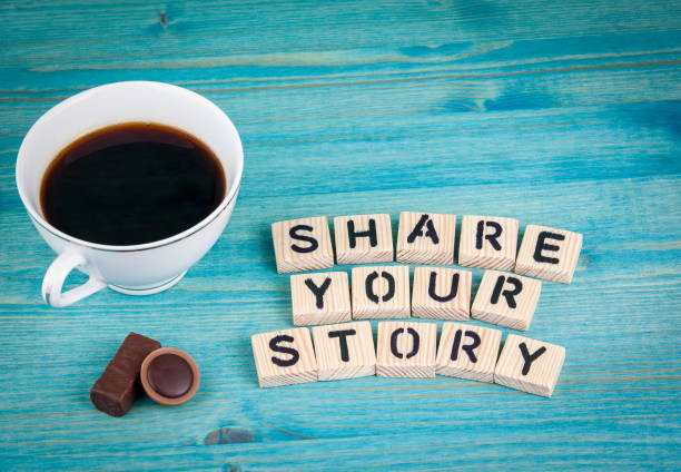 share your story. coffee mug and wooden letters on wooden background - sharing stock photos and pictures