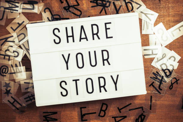 Share Your Story Share Your Story text on the lightbox with plastic alphabets scattered on wood background storytelling stock pictures, royalty-free photos & images