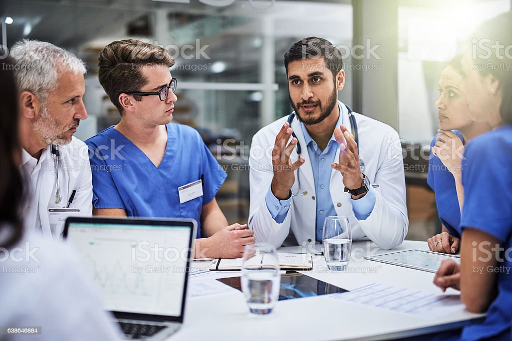 Shared medical knowledge benefits his coworkers and patients Shot of a team of doctors having a meeting Adult Stock Photo