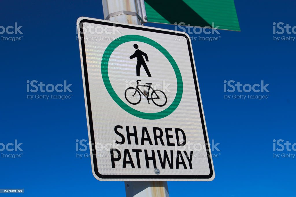 Shared Pathway Sign Against a Blue Sky stock photo