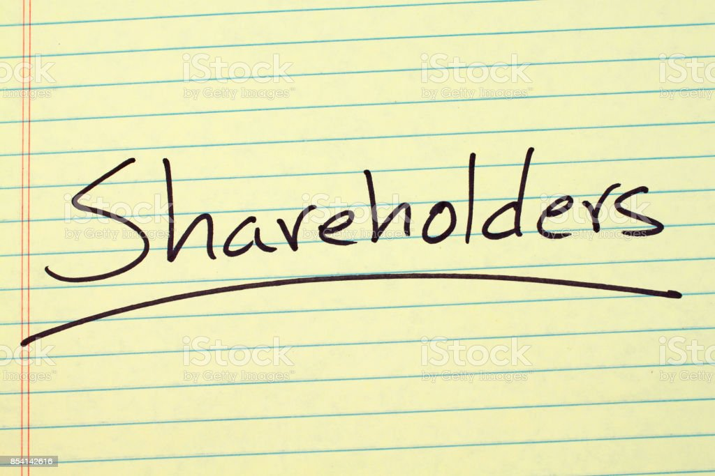 Shareholders On A Yellow Legal Pad stock photo