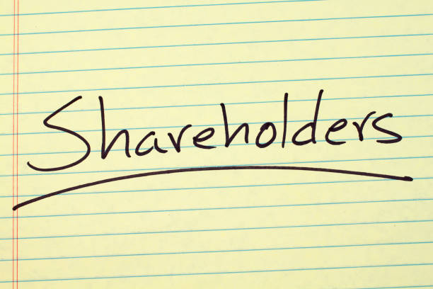 Shareholders On A Yellow Legal Pad - foto stock