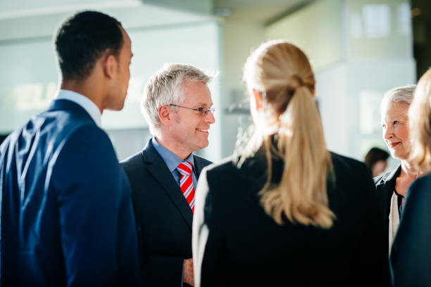 Shareholders Talking To Business Team Leaders - foto stock