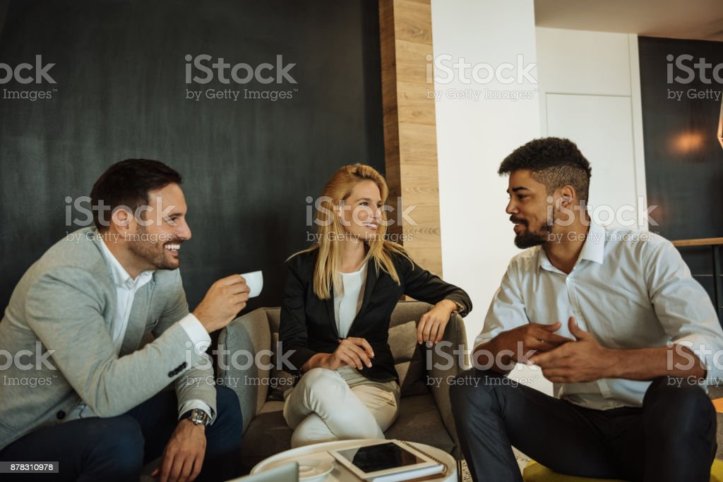 Sharing a few office stories stock photo