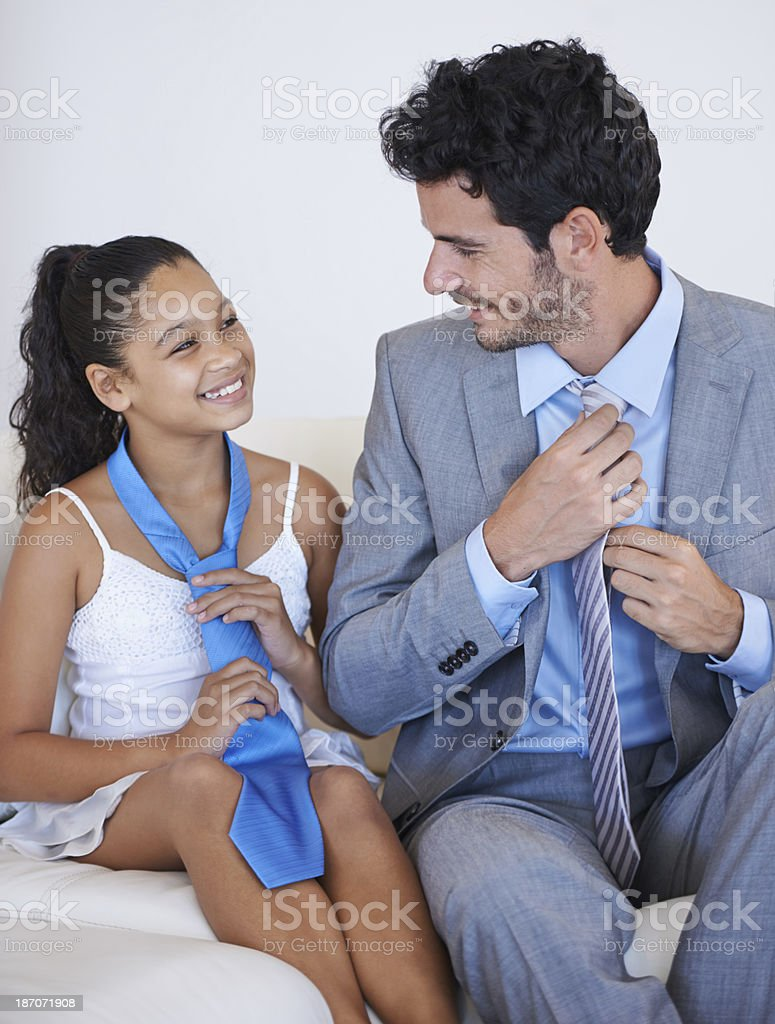 Sharing a moment between father and daughter... royalty-free stock photo