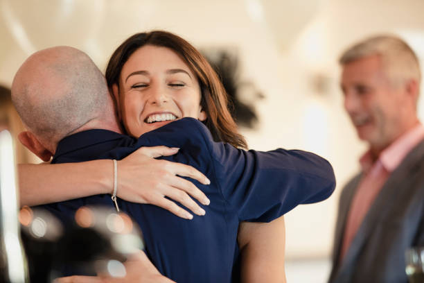 sharing a moment with dad on my wedding day - father and daughter stock photos and pictures