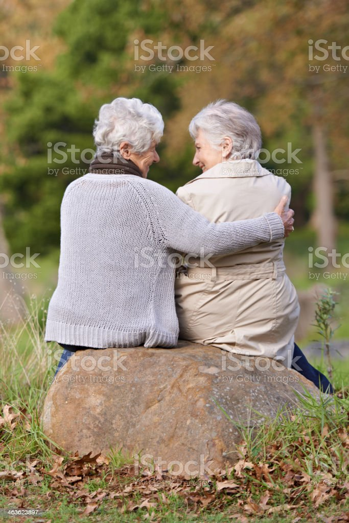 Sharing a moment with her friend stock photo