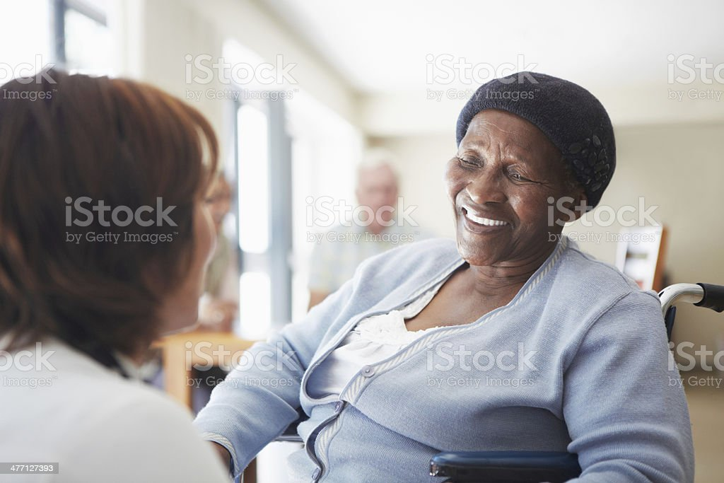 Sharing a smile with her caregiver stock photo