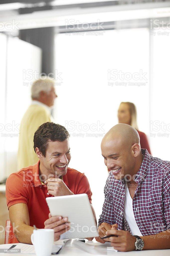 Sharing an inside joke royalty-free stock photo