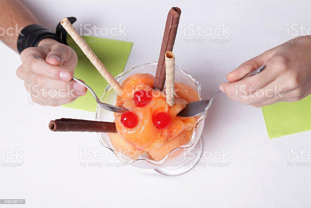 Sharing an orange sorbet royalty-free stock photo