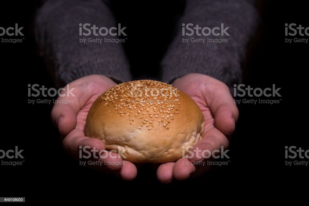 Sharing bread. Poverty concept. stock photo
