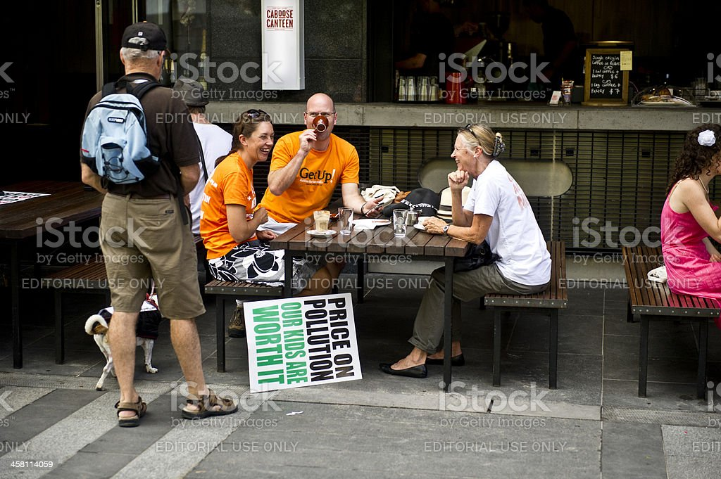 Sharing Coffee After Climate Change Protest stock photo