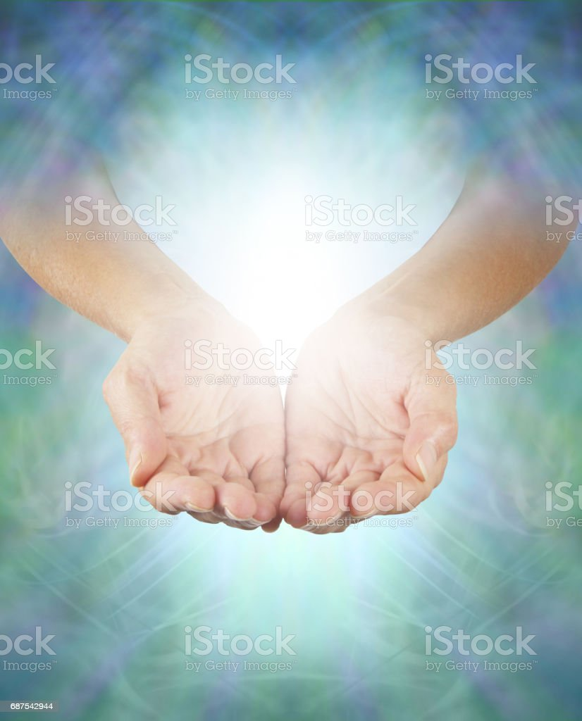 Sharing Divine Healing Energy stock photo