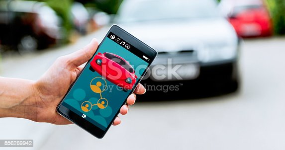 istock Sharing drive or calling a taxi service with mobile phone and an app 856269942