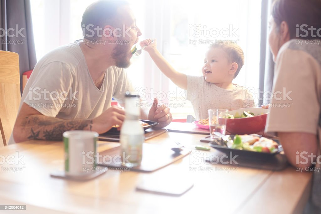 Sharing food with daddy stock photo