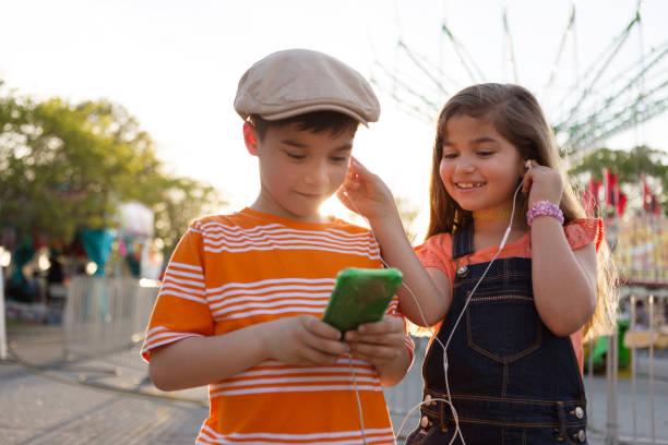 Sharing Headphones stock photo
