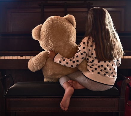 Sharing Her Talents With Her Teddy Stock Photo - Download Image Now