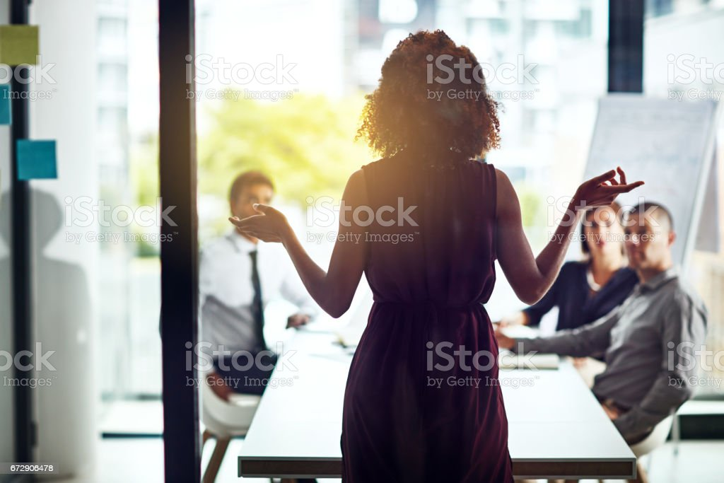 Sharing her vision for a new business venture Shot of a group of colleagues having a meeting in a modern office Adult Stock Photo