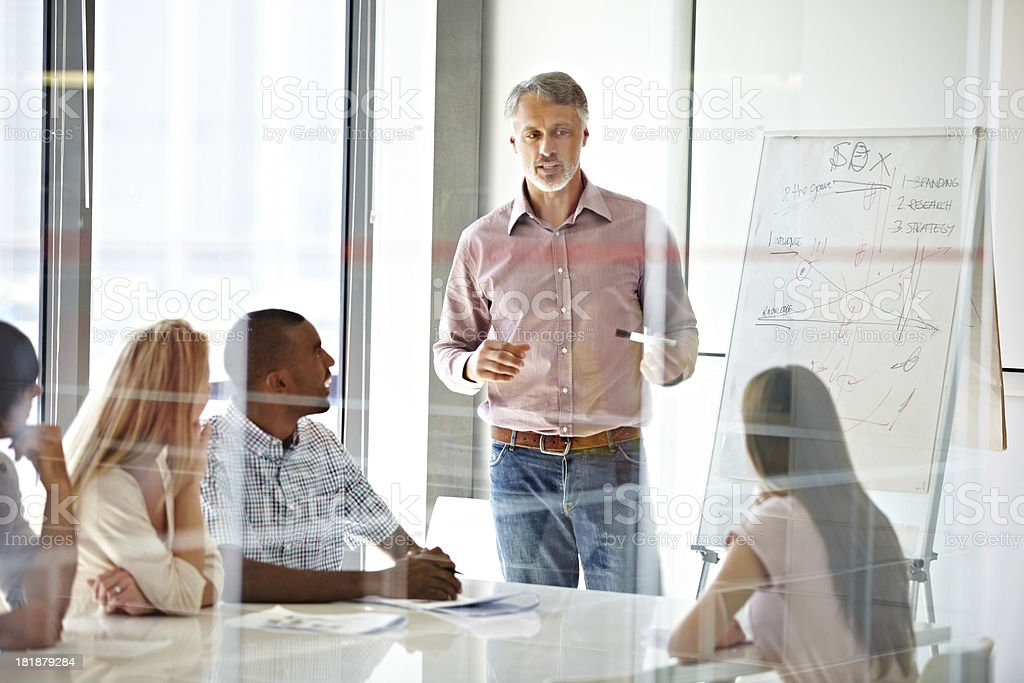Sharing his experience and teaching them about business royalty-free stock photo