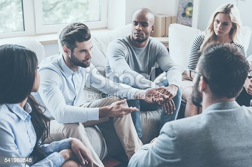 541975802 istock photo Sharing his problems with group. 541969848