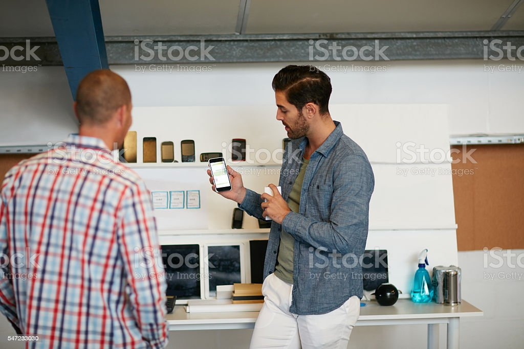Sharing his thoughts on a developing app stock photo