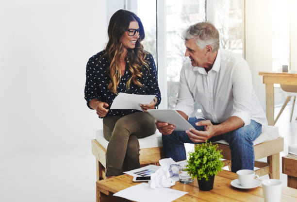 Sharing ideas despite the age barrier Shot of creative employees working in a modern office despite stock pictures, royalty-free photos & images