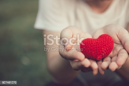 istock Sharing Love and Heart red color on women hand in valentine's day vintage color tone 927461270