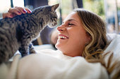 Women with her cat share tenderness